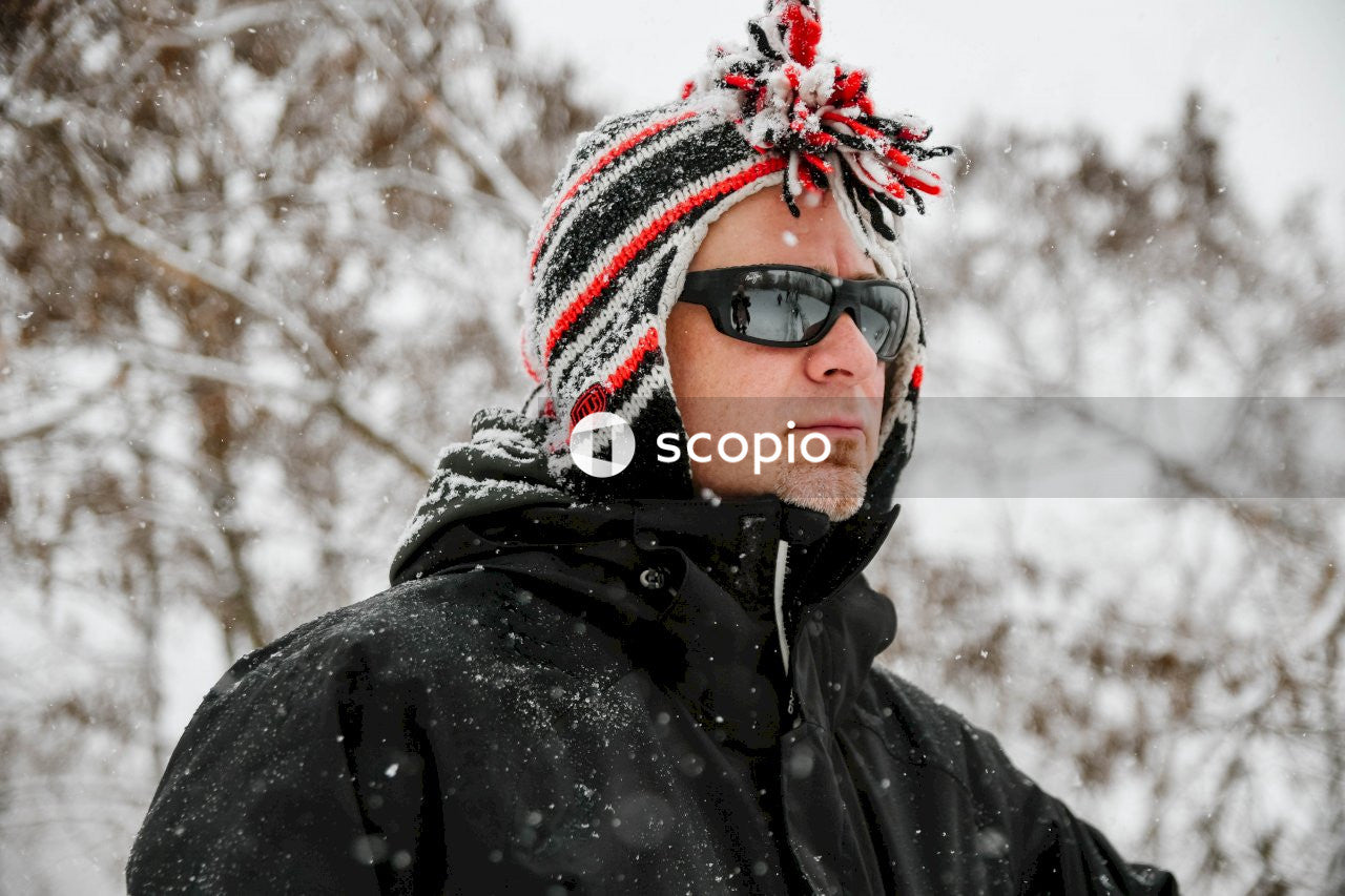 Person in black and white knit cap and black jacket