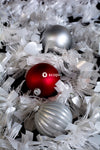 Red and silver baubles on white and gray bouquet