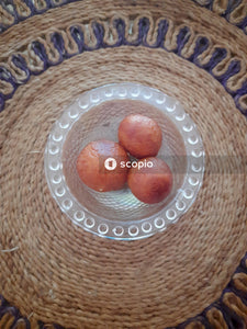 Red round fruits on white round plate
