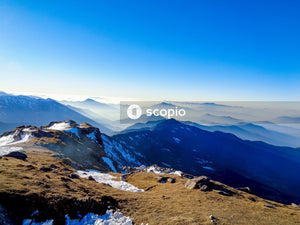 Snow covered mountains under blue sky