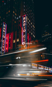 Time lapse photography of city buildings during night time