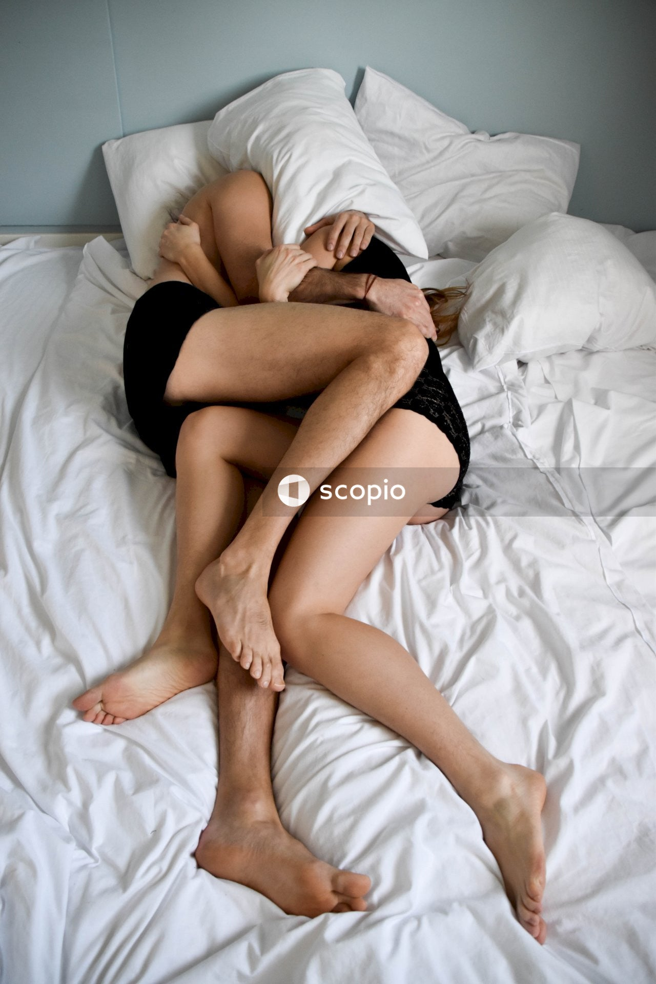 Woman in black panty lying on bed