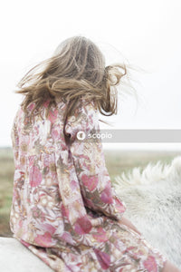 Woman in white and pink floral long sleeve shirt