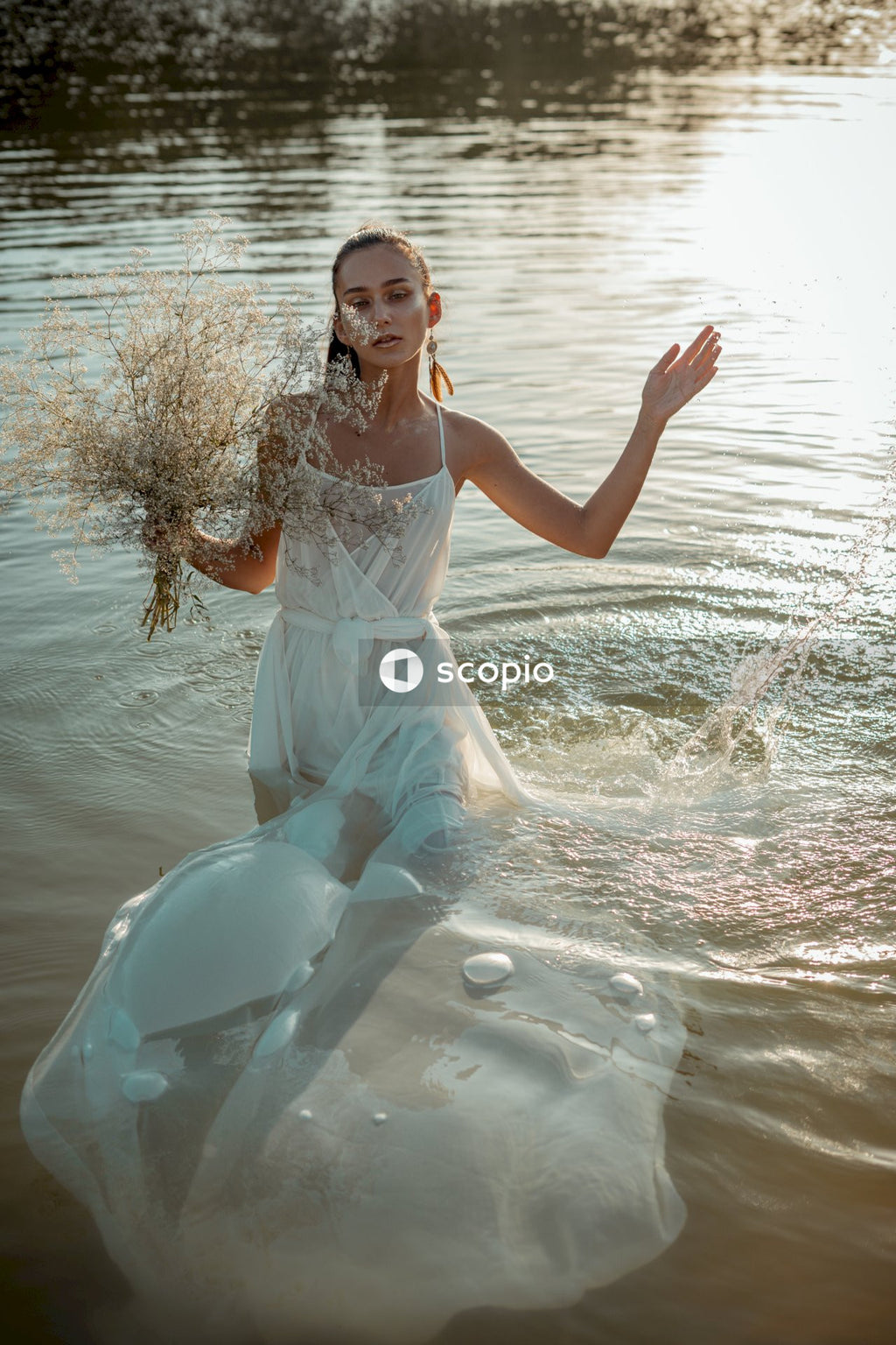 Woman in white dress on water