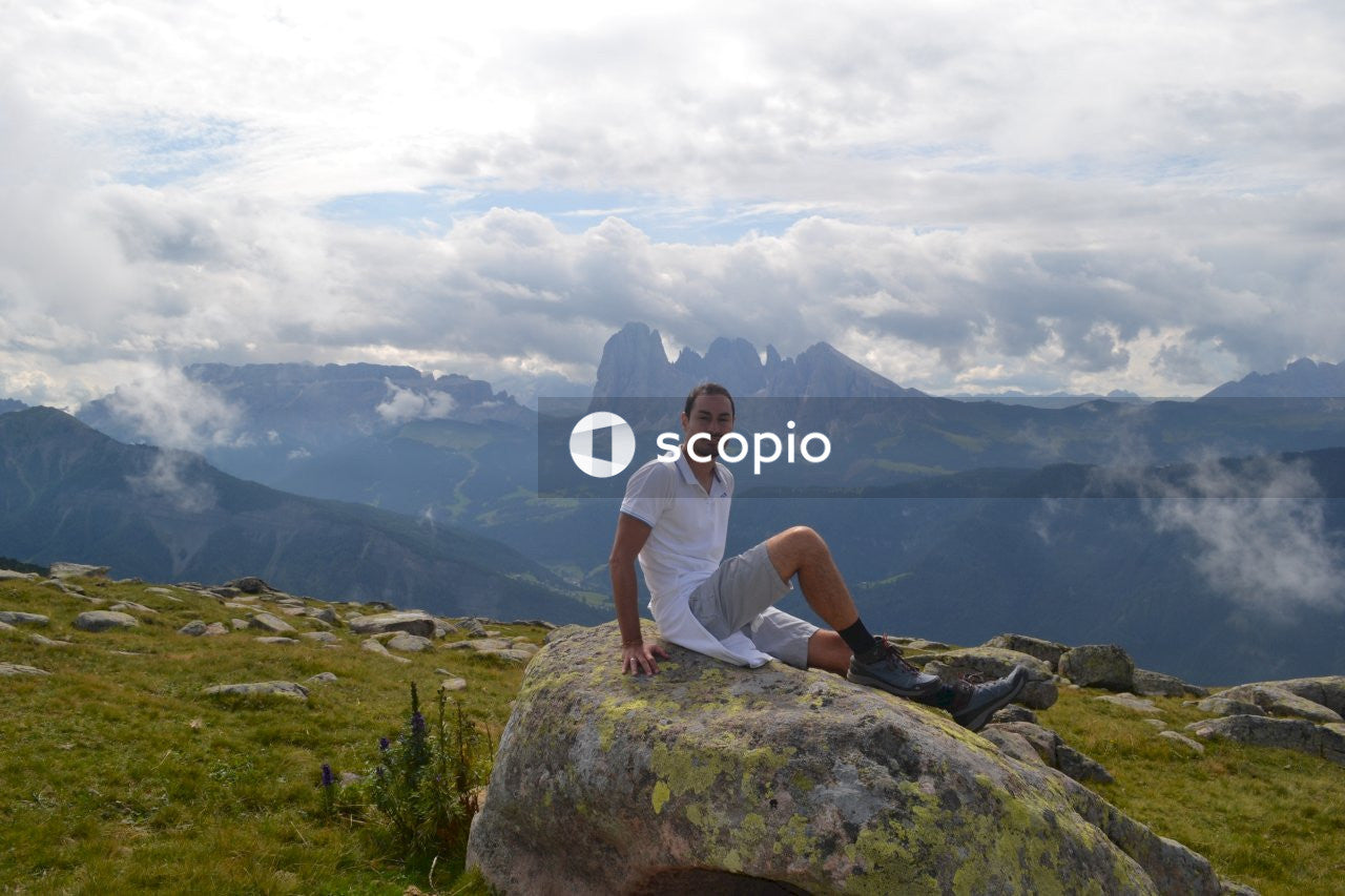 Woman in white t-shirt sitting on rock