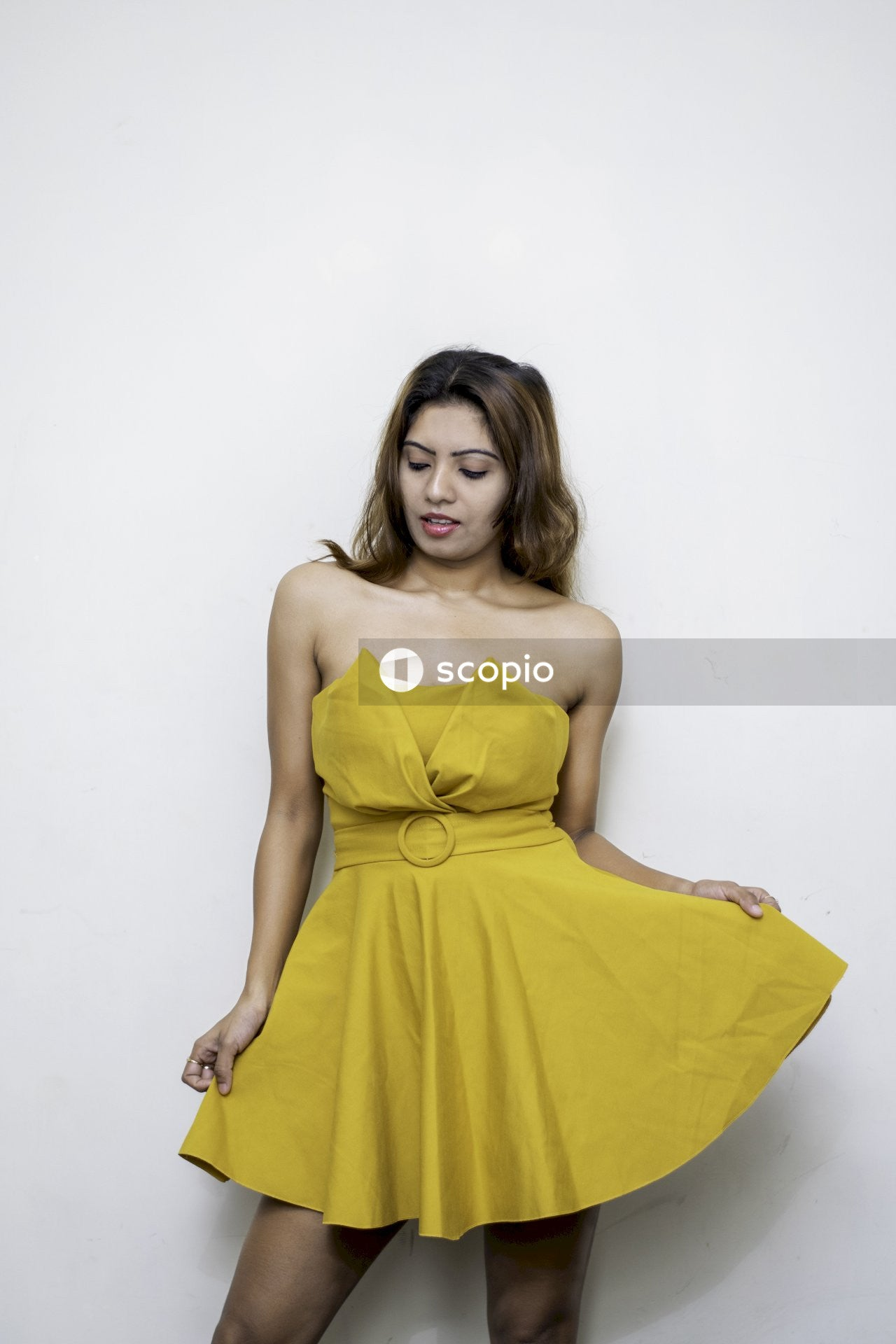 Woman in yellow tube dress