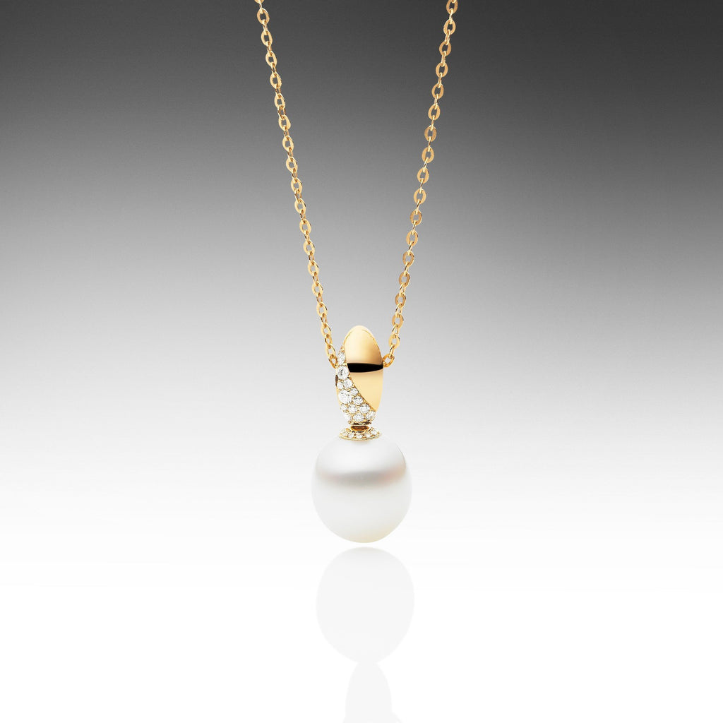 pearl and gold diamond pendant yellow necklace swirl