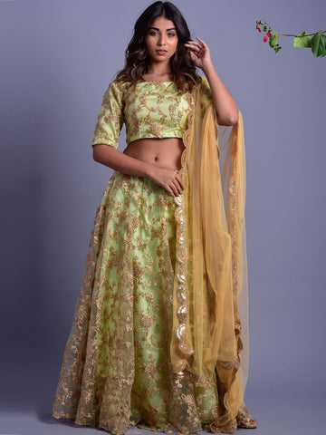 Green lehenga with golden and rose designs