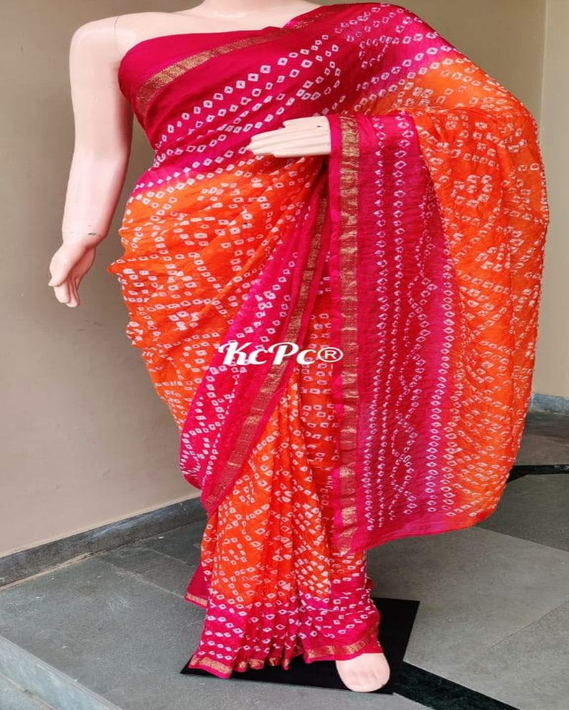 Pink N orange dott bandhej saree