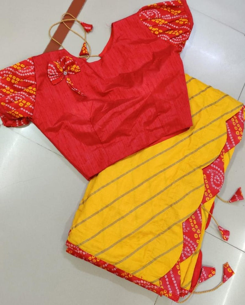 Yellow dola with bandhej latkan saree