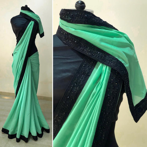 Green silk saree with black border