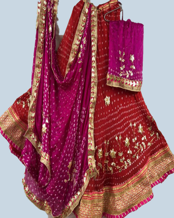 Red nd pink Bandhej lehenga with crep dupatta