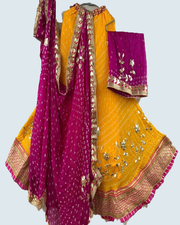 Pink nd yellow Bandhej lehenga with crep dupatta