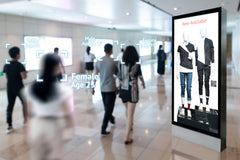 Intelligent Digital Signage in retail shopping Mall. – Shutterstock