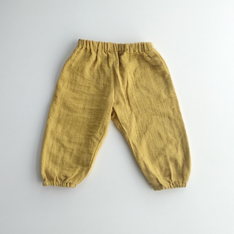 Unisex balloon pants in marigold