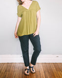Front, loose fit Gather Sac Top by Pekho, in green diamond weave rayon.