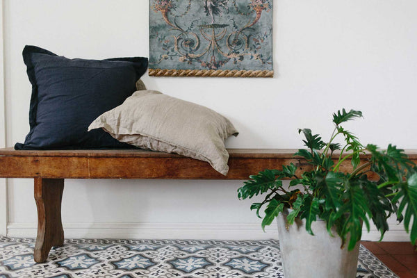 Border Edge Cushions by Pekho, in charcoal and natural, 100% linen.