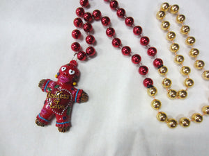 Goddess of Love Voodoo Medallion on a Red and Gold Specialty Bead