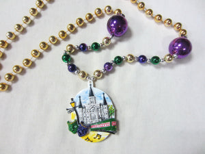 Cathedral, Streetcar and Lamp Medallion on a Purple Green Gold Specialty Bead