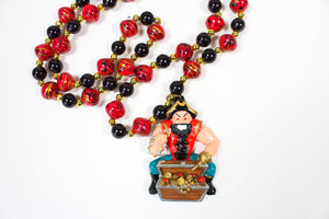 Muscular Pirate with his Gold Chest and Black and Red Bead