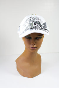 White Cap with a Sequined Fleur de Lis Symbol