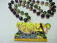 Mardi Gras Float with Music Notes on a Purple Green Gold Specialty Beads