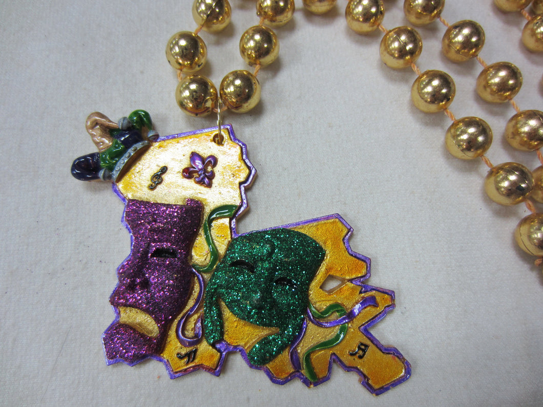 Glitter Comedy Tragedy on a Louisiana State Backdrop and Gold Specialty Beads