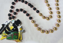 Street Musician (Saxophone Player), Streetcar and Street Lamp on a Black and Gold Specialty Beads