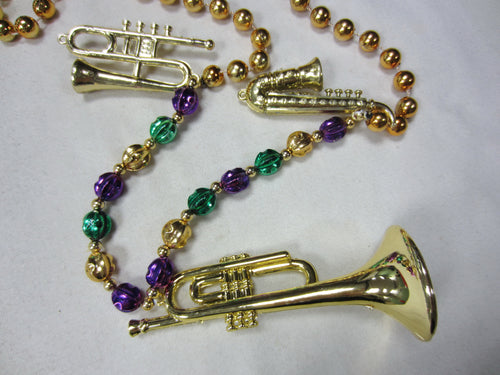 Gold Trio of Musical Instruments (Saxophone, Trombone, Trumpet) on a Purple Green Gold Specialty Beads