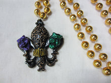 Black Fleur de Lis with Comedy Tragedy on a Gold Specialty Bead
