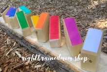 Wooden block houses with slanted colourful tops