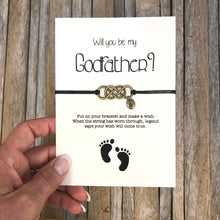 "Godfather bracelet with customized initial charm, placed on ""Will you be my godfather"" proposal card"