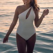 woman wearing kierra one-sided maillot, ivory color, close up