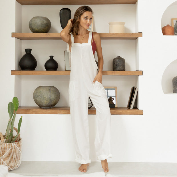 woman wearing lounge all-day overalls in white