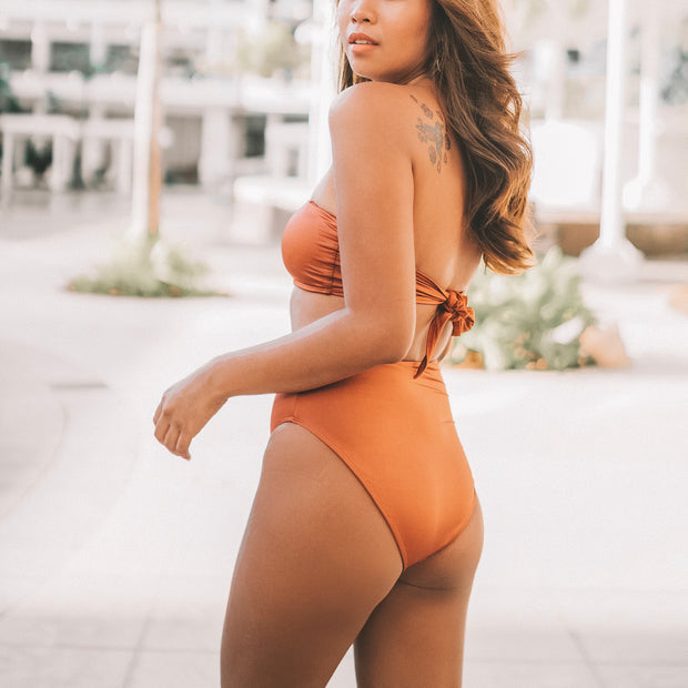 copper color avana maillot, side view