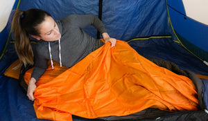 getting into the orange sleeping bag