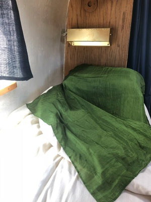 green sleeping bag in air stream