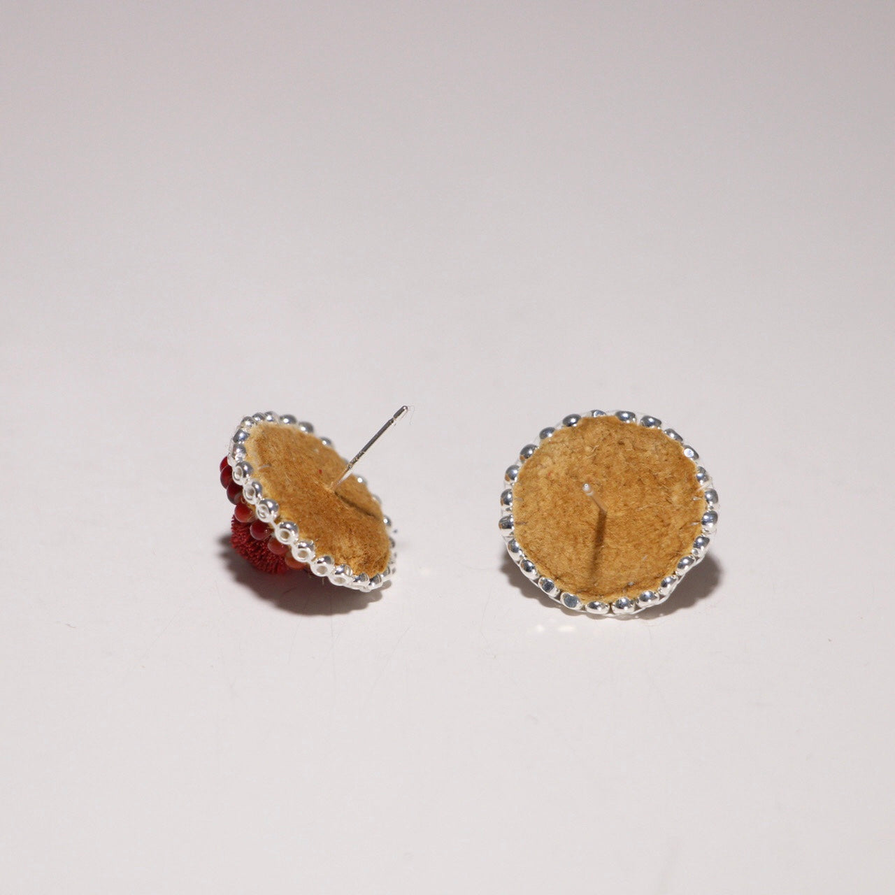Earrings backed with caribou hide and sterling silver stud.