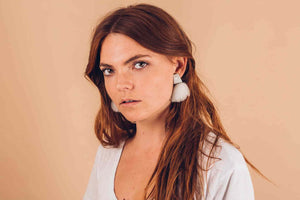 Yomo Studio cloudy pearl earrings in grey. Materials include: concrete, AAA pearl, and organic wool.