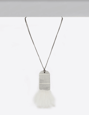 81 Dots in the Clouds Necklace This Yomo Studio cloud collection necklace is made of: concrete, brass, organic wool, and wax string.