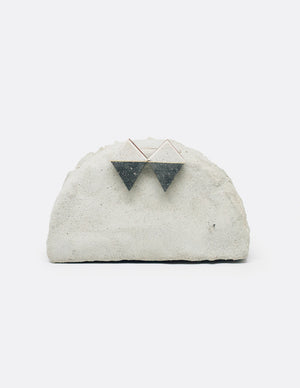 Yomo Studio black & white rhombus earrings. Materials include: concrete, brass, and walnut wood.