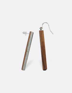 Yomo Studio rectangle brass earrings. Materials include: concrete and brass.