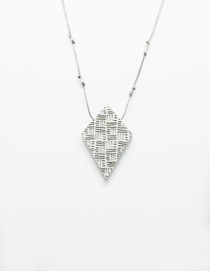 Yomo Studio rhombus lines necklace. Materials include: concrete, metal beads, and wax string.