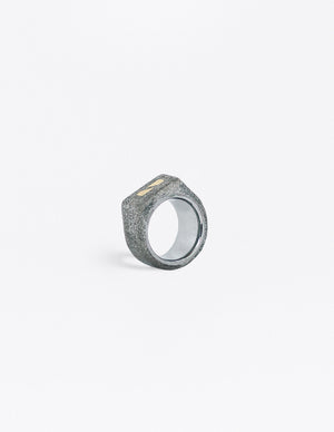 Yomo Studio 6mm split brass ring. Materials include: concrete, brass, and tungsten ring.
