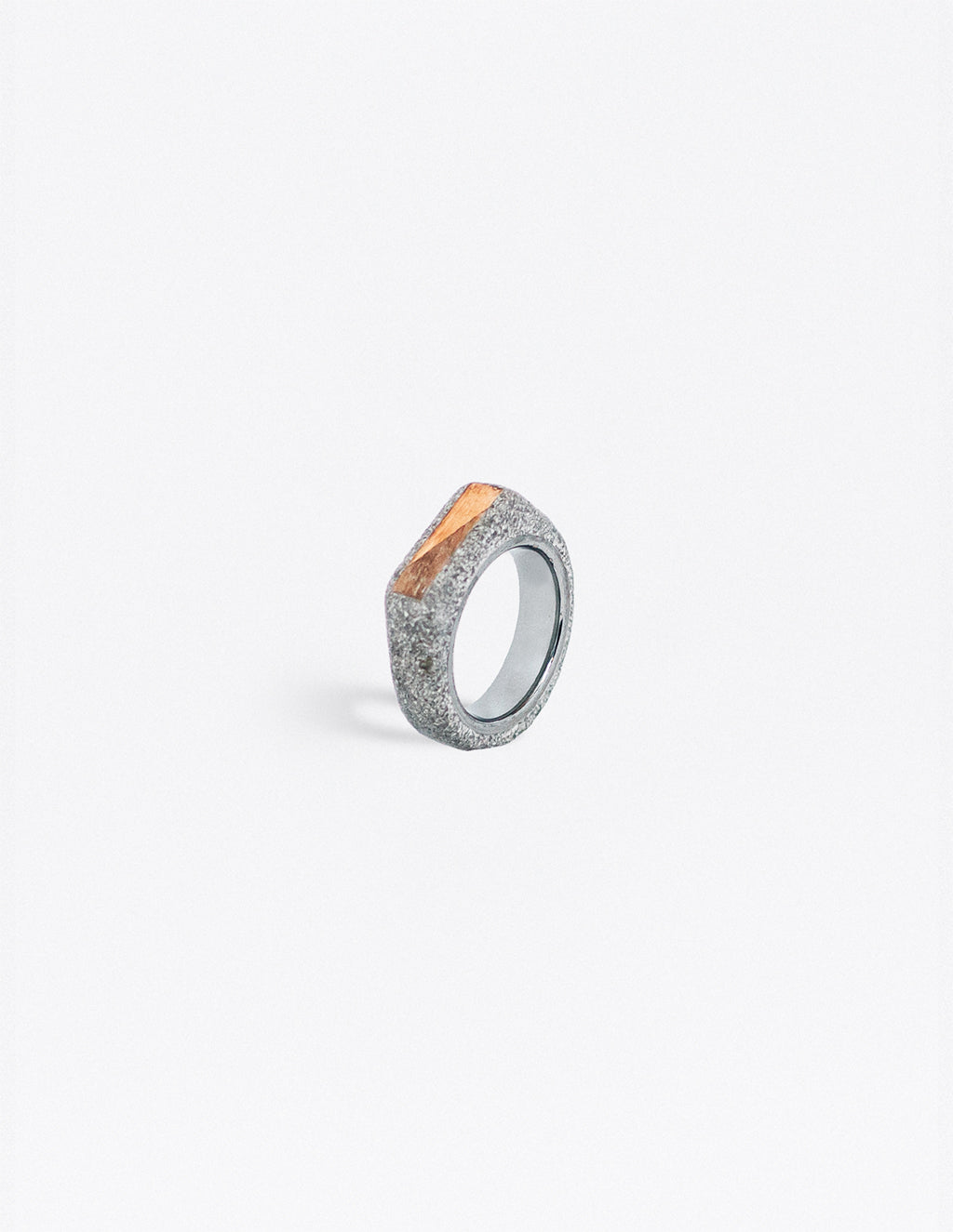 Yomo Studio grey 6mm triangles ring. Materials include: concrete, tungsten ring, walnut and pine wood.