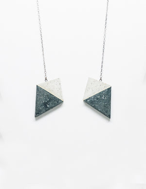 Yomo Studio concrete heart necklace. Materials include: concrete, brass, and silver chain.