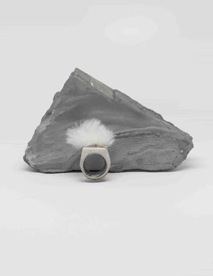 Yomo Studio cloudy ring in grey. Materials include: concrete, brass, and organic wool.