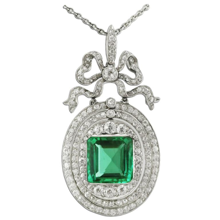 4 Carat Colombian Emerald Diamond Platinum-Topped Gold Pendant. Circa 1910