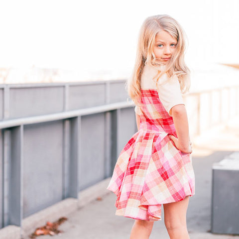 Short sleeve girls dress with pink plaid bustle back