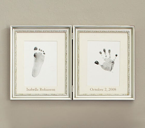 Silver frame with baby handprint and footprints